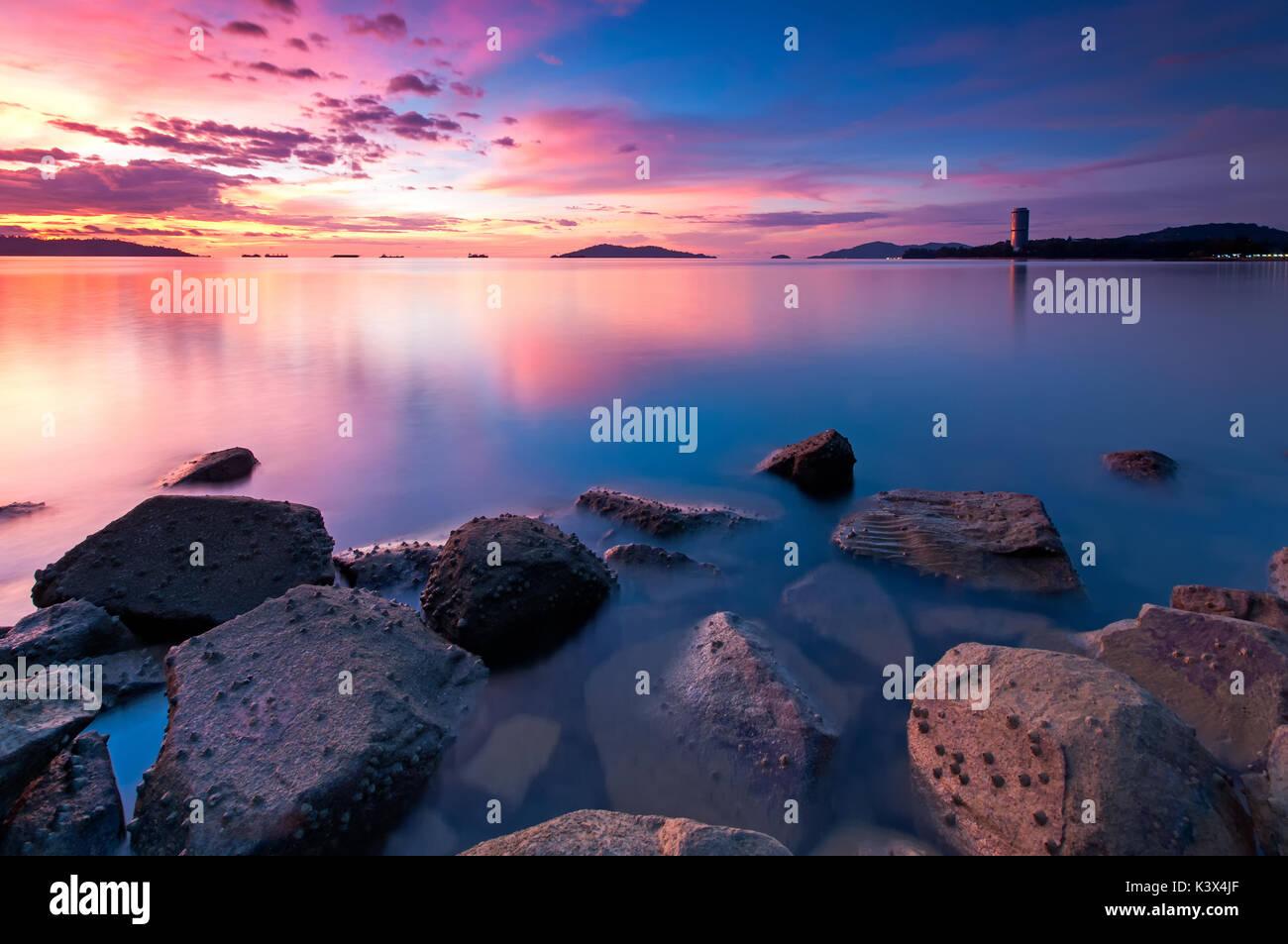 Beautiful sunset in Kota Kinabalu beach, Tanjung Lipat in Sabah Borneo, Malaysia. - Stock Image