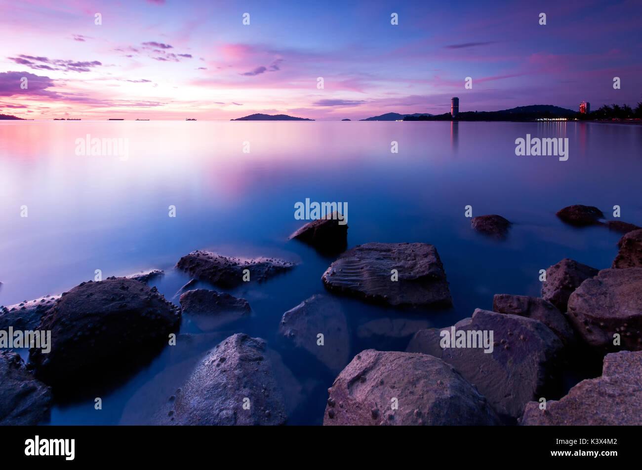 Long exposure if seascape at dusk in Kota Kinabalu beach, Tanjung Lipat in Sabah Borneo, Malaysia. - Stock Image