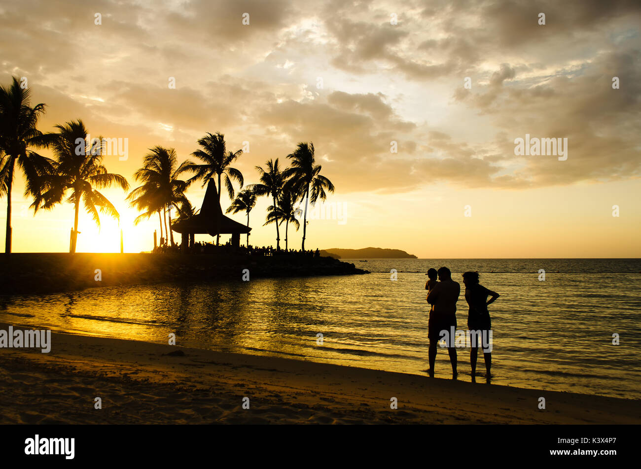 Silhouettes of unidentified people at the beach during during sunset in Kota Kinabalu, Sabah Borneo, Malaysia. - Stock Image