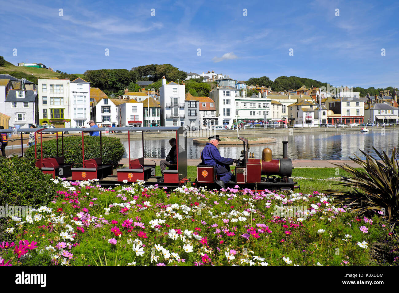 Hastings, UK. Miniature train on the seafront railway, on the promenade by the boating lake. Hastings Old Town seafront, East Sussex, England, UK, GB - Stock Image