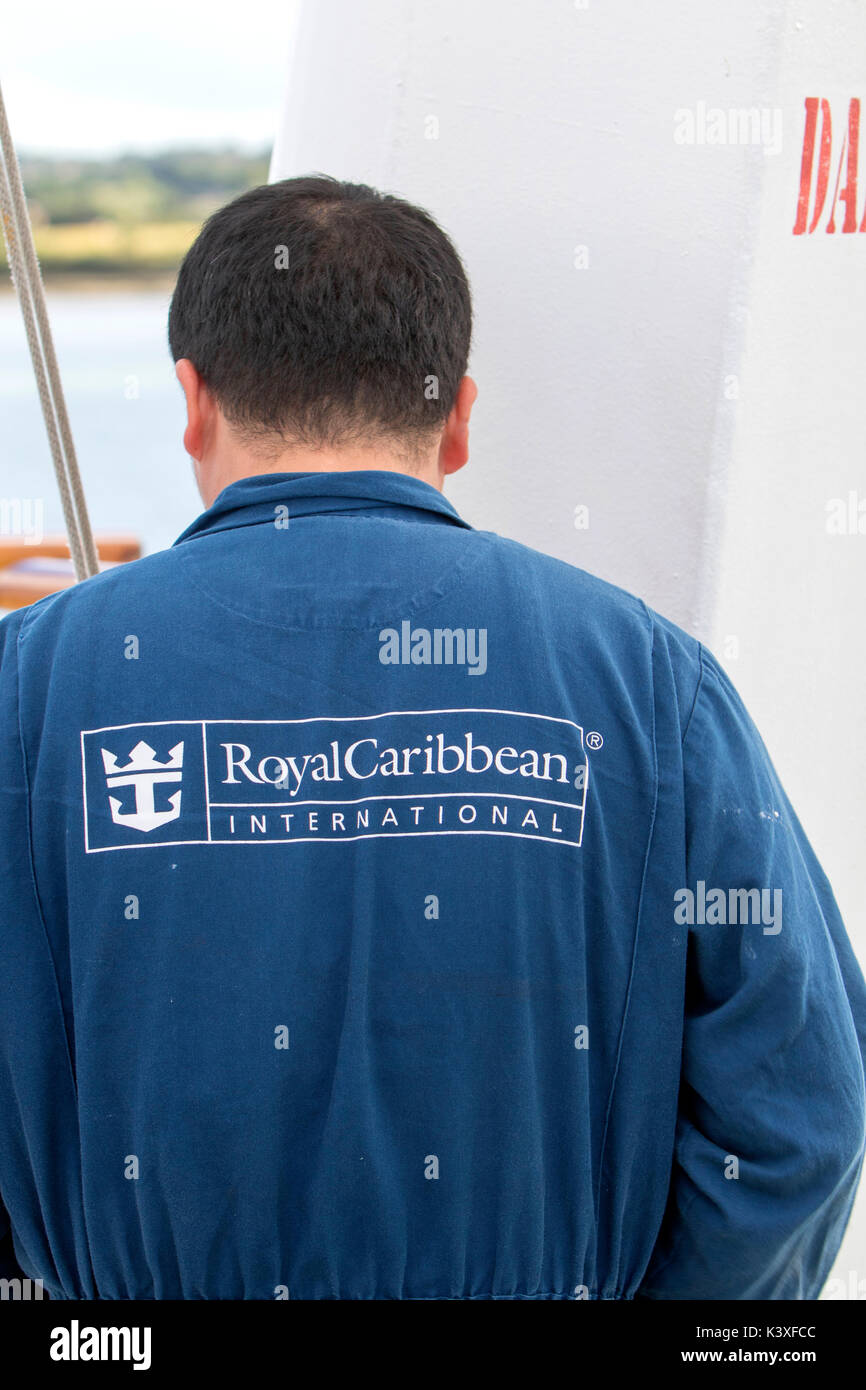 Royal Caribbean International Cruises Engineer wearing blue overalls - Stock Image