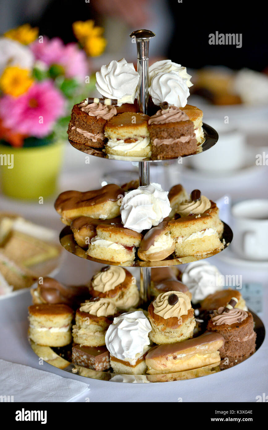 Cake stand with mini cake selection - Stock Image