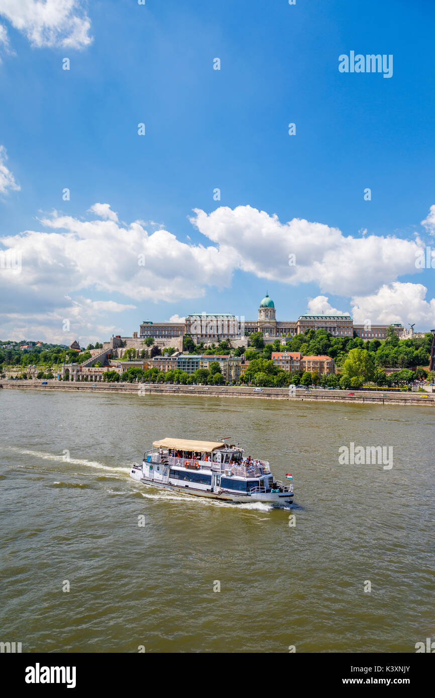 Tourist riverboat on the River Danube and the Buda Castle Royal Palace in Buda, Budapest, capital city of Hungary, Stock Photo