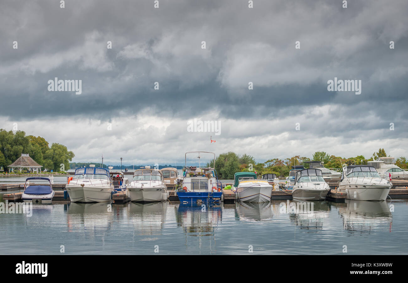 Small pleasure boats safely docked in the harbour at Orillia Ontario Canada as severe storms approch. - Stock Image