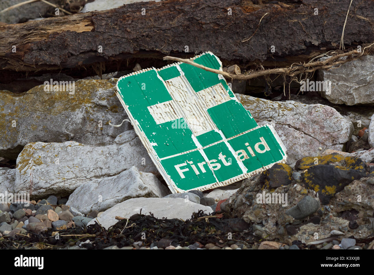 Plastic first aid sign washed up on beach in Lancashire - Stock Image