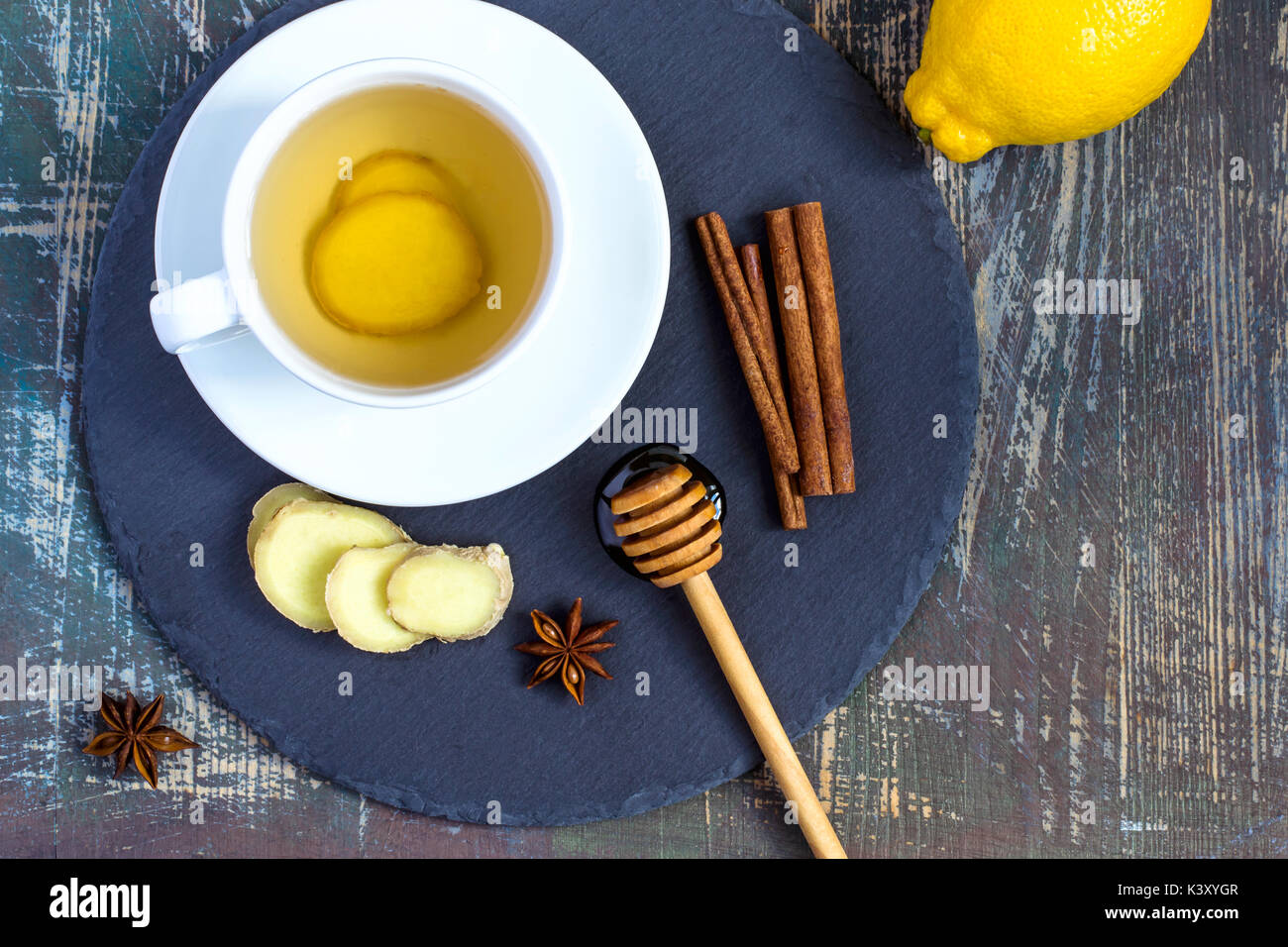 Ginger hot  immunity boosting Vitamin natural drink With Lemon, honey and cinnamon and ingredients - Stock Image