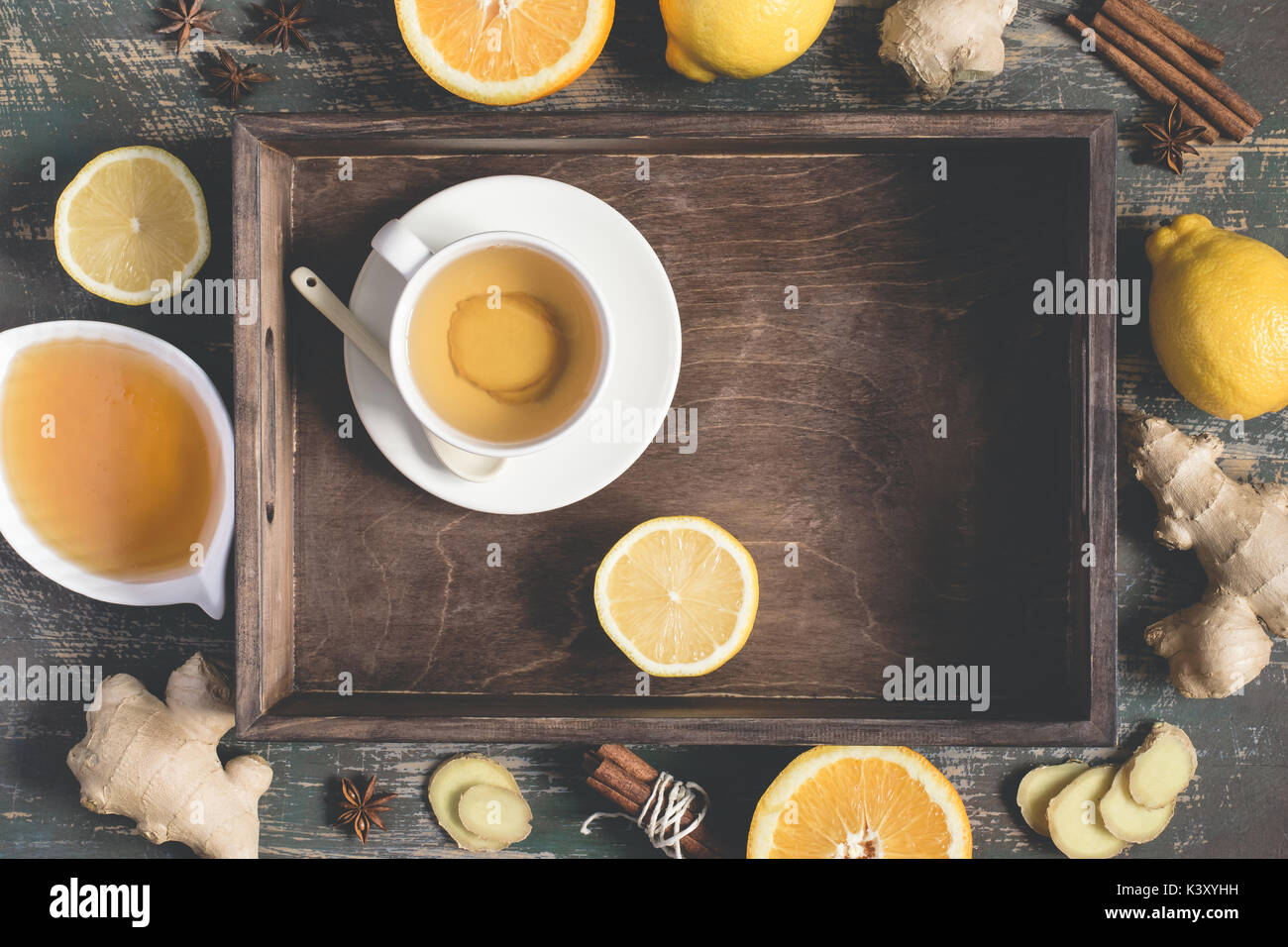 Ginger hot  immunity boosting Vitamin natural drink With Lemon, honey and cinnamon On tray and ingredients - Stock Image