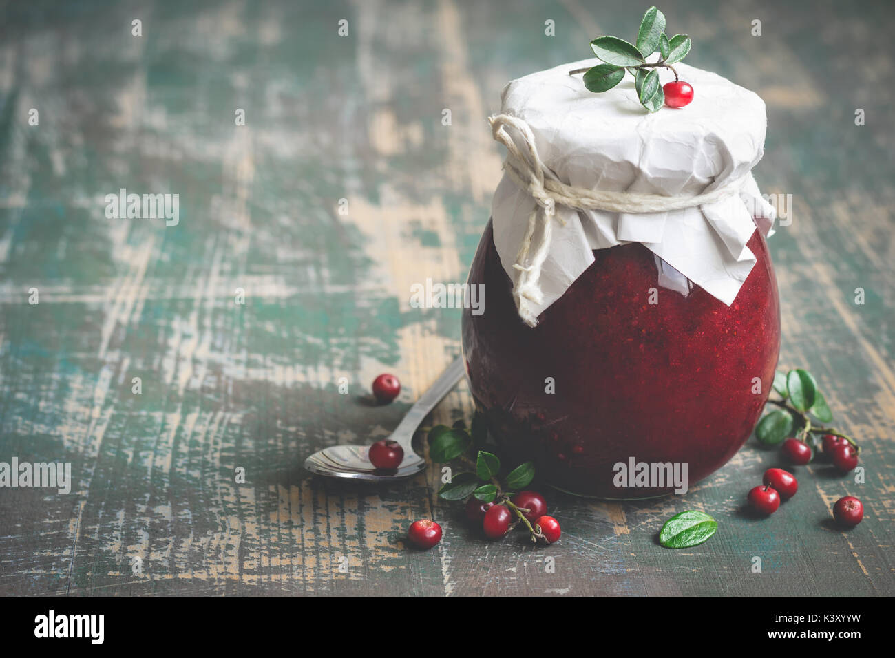 Lingonberry jam in jar and fresh berries. Selective focus, copy space  - Stock Image