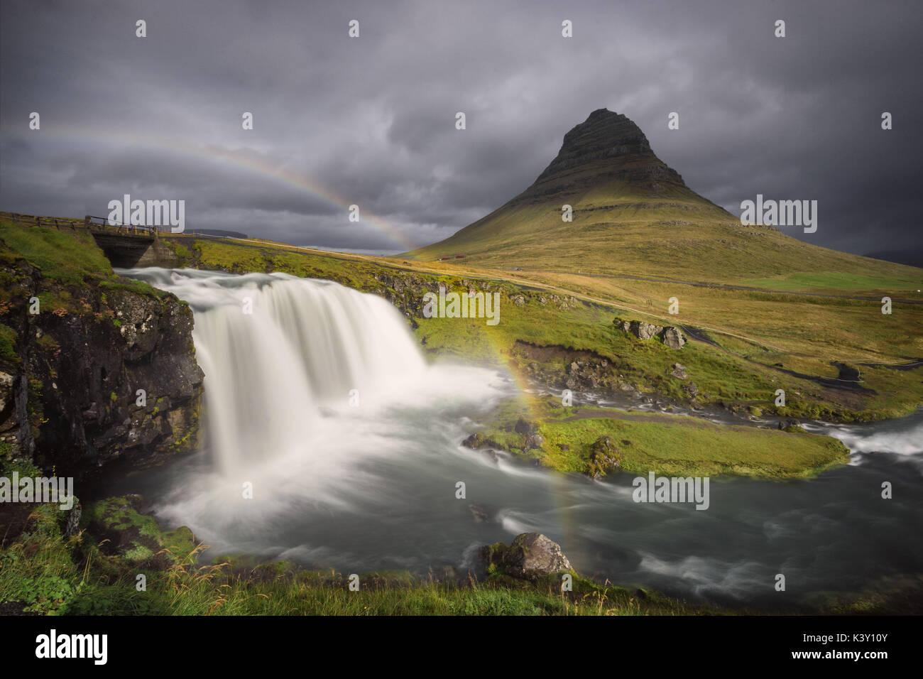Kirkjufellsfoss view with a rainbow - Stock Image