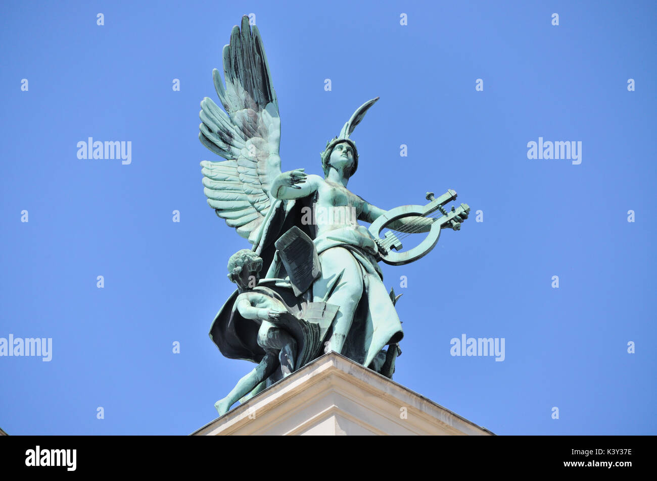 Muse with a harp on the roof of theater, Lvov, Ukraine - Stock Image