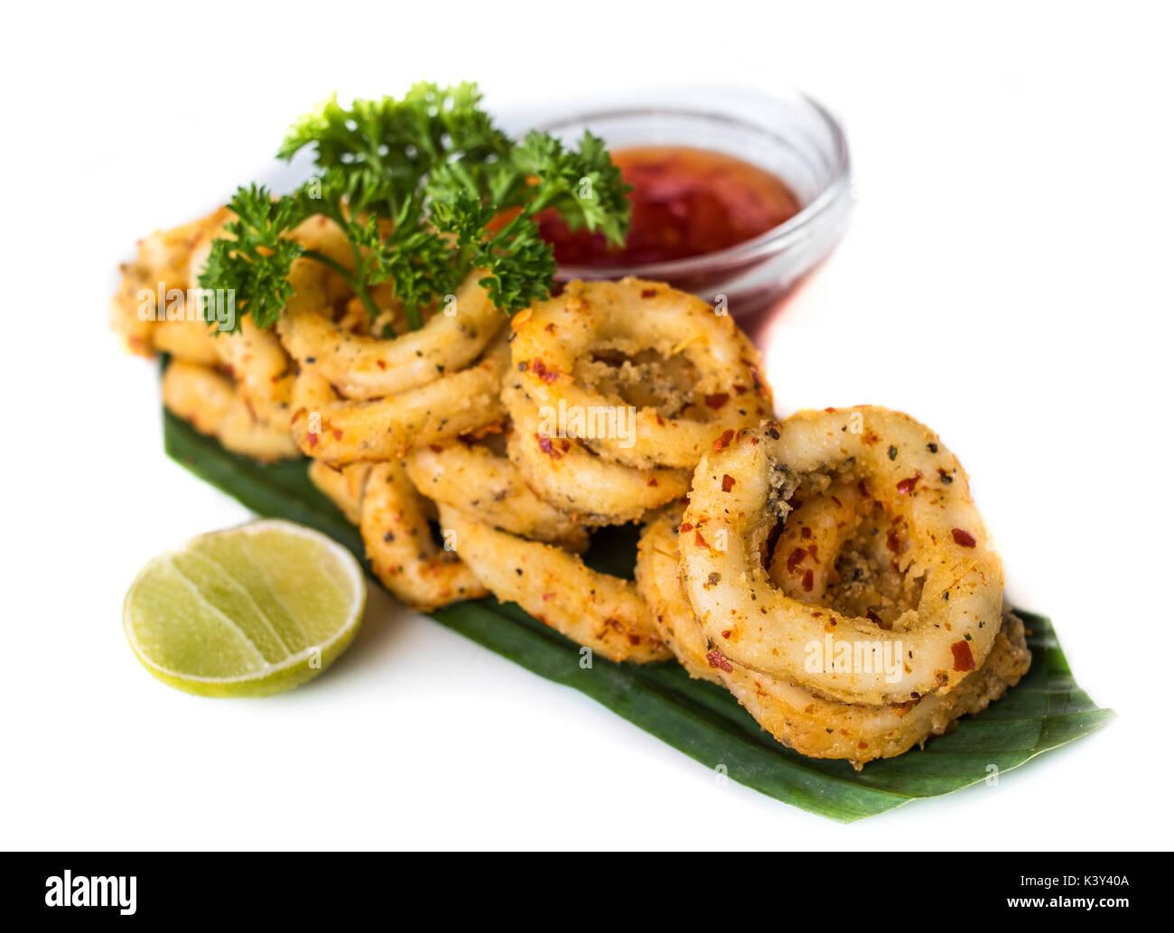 Deep fried calamari rings with sauce bowl - Stock Image