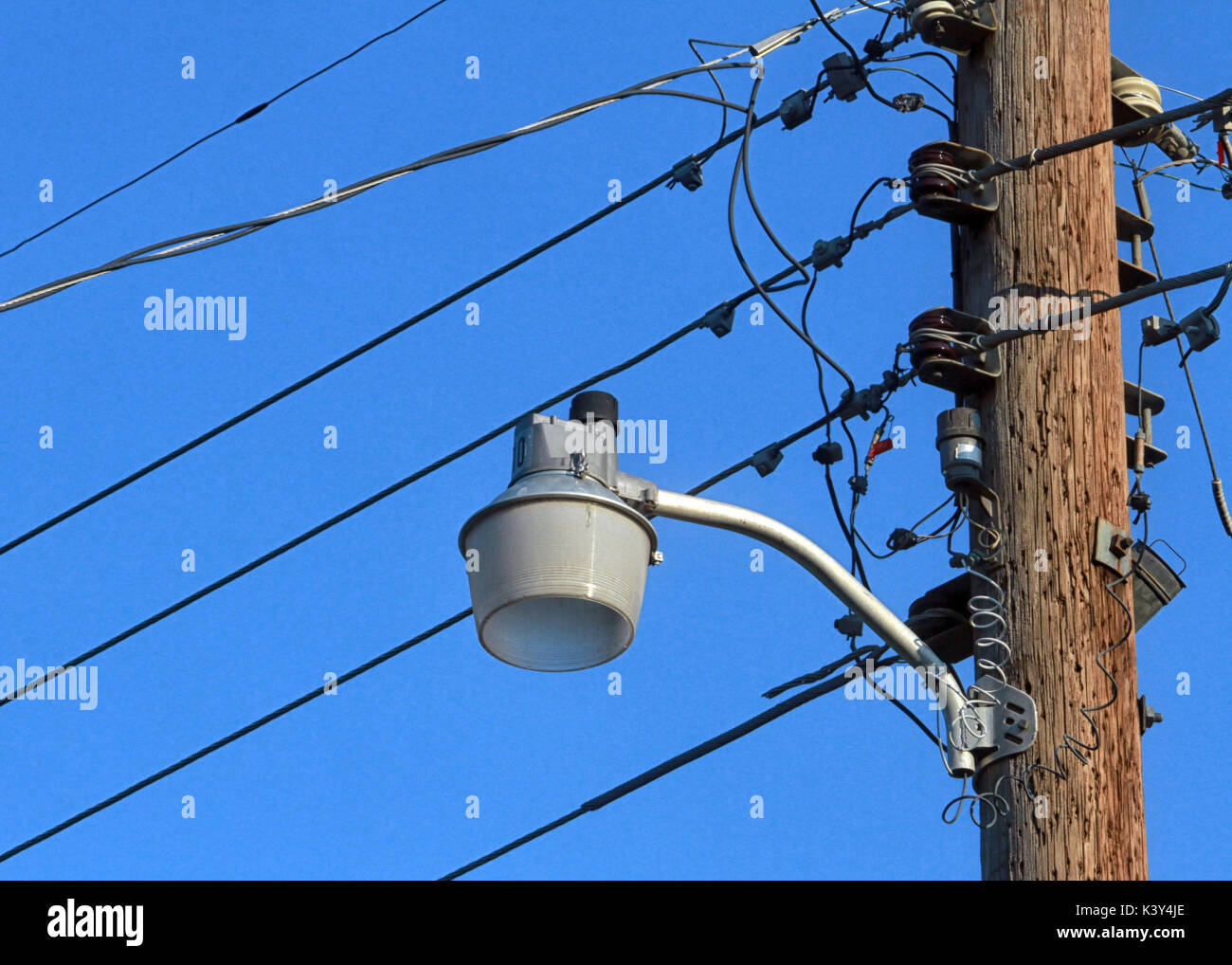 Wooden Street Lamp Post Stock Photos Wiring A An Unlit On Wood Pole With Telephone Wires Stands Out Against Blue