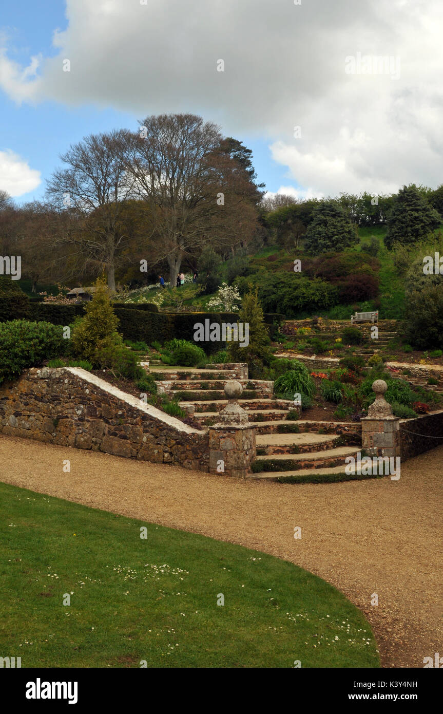 Mottistone Manor House on the Isle of Wight showing the formal gardens an stone steps with walls and symmetrical Stock Photo