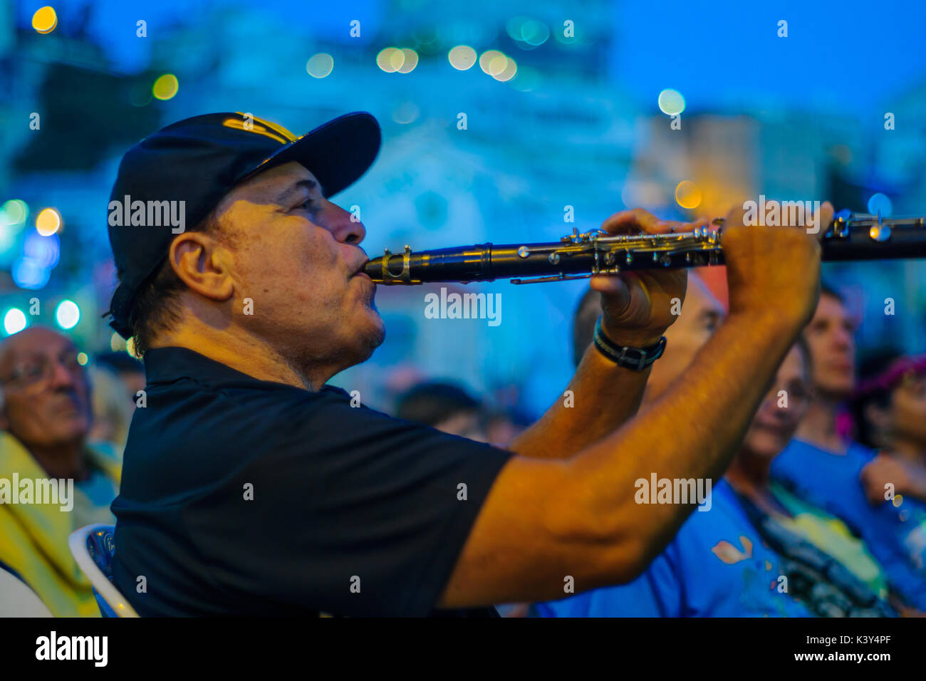 SAFED, ISRAEL - AUGUST 23, 2017: A man in the crowd play Clarinet at the Klezmer Festival in Safed (Tzfat), Israel. Stock Photo