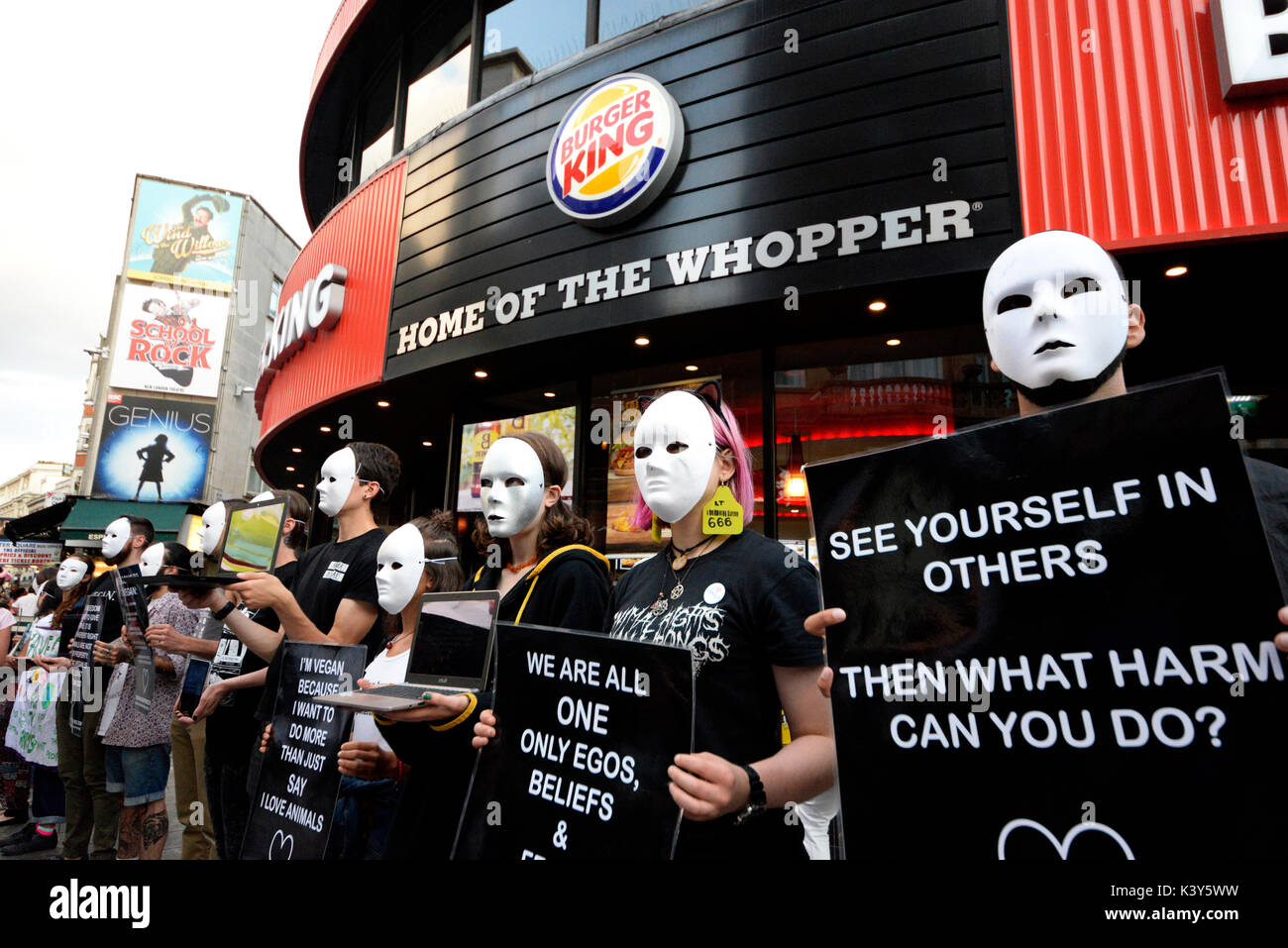 Earthlings Experience animal rights protesters outside Burger King attempting to convert the public to become vegan in London. Space for copy - Stock Image