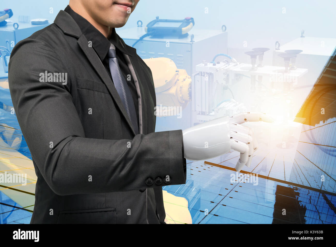 Artificial intelligence (ai) robot technology in smart factory concept. Male business suit with robotic hand point finger and double exposure of autom - Stock Image