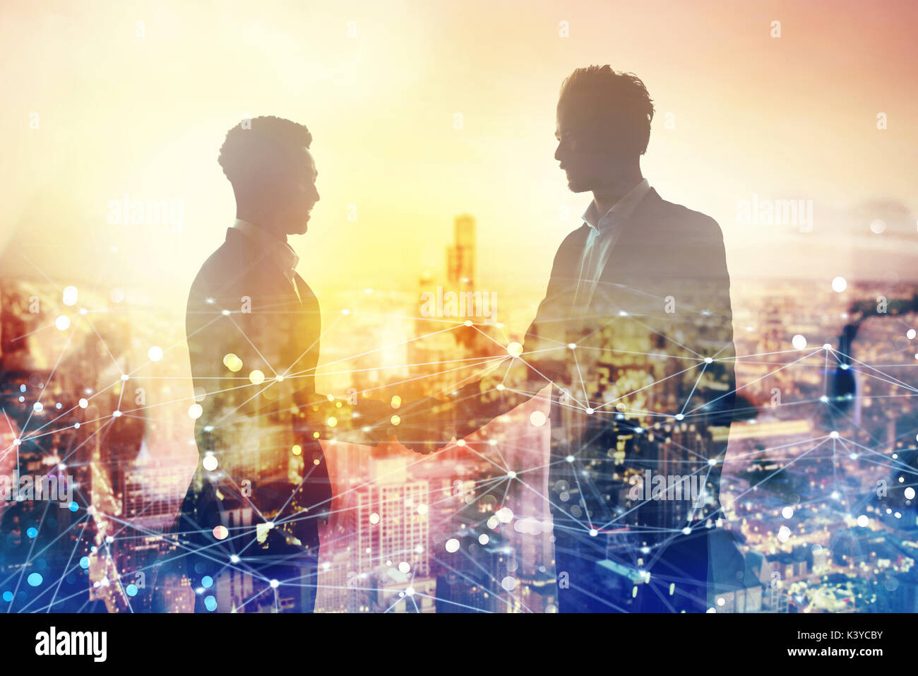 Handshake of two businessperson in office with network effect. concept of partnership and teamwork - Stock Image