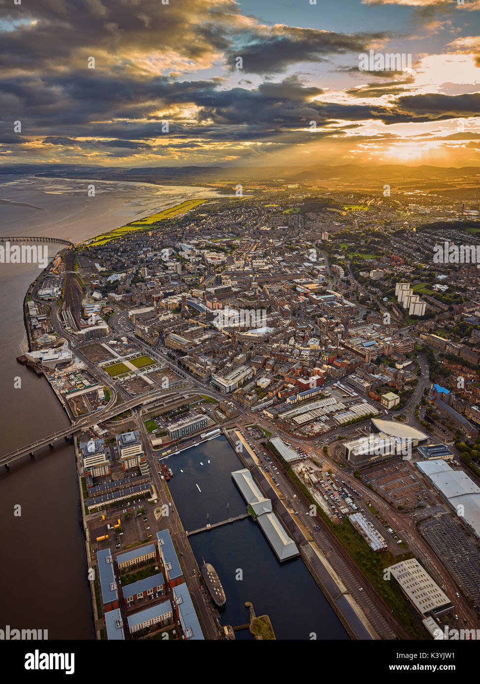 An aerial capture of the City of Dundee as the sun sets over the city Stock Photo