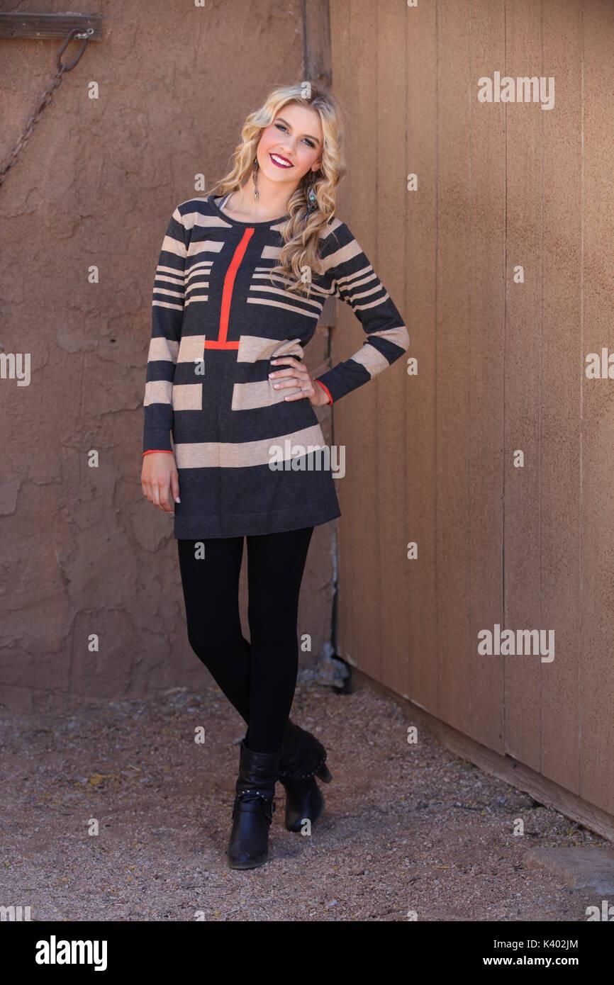 0da902f153 young blonde woman wearing sweater dress and leggings Stock Photo ...