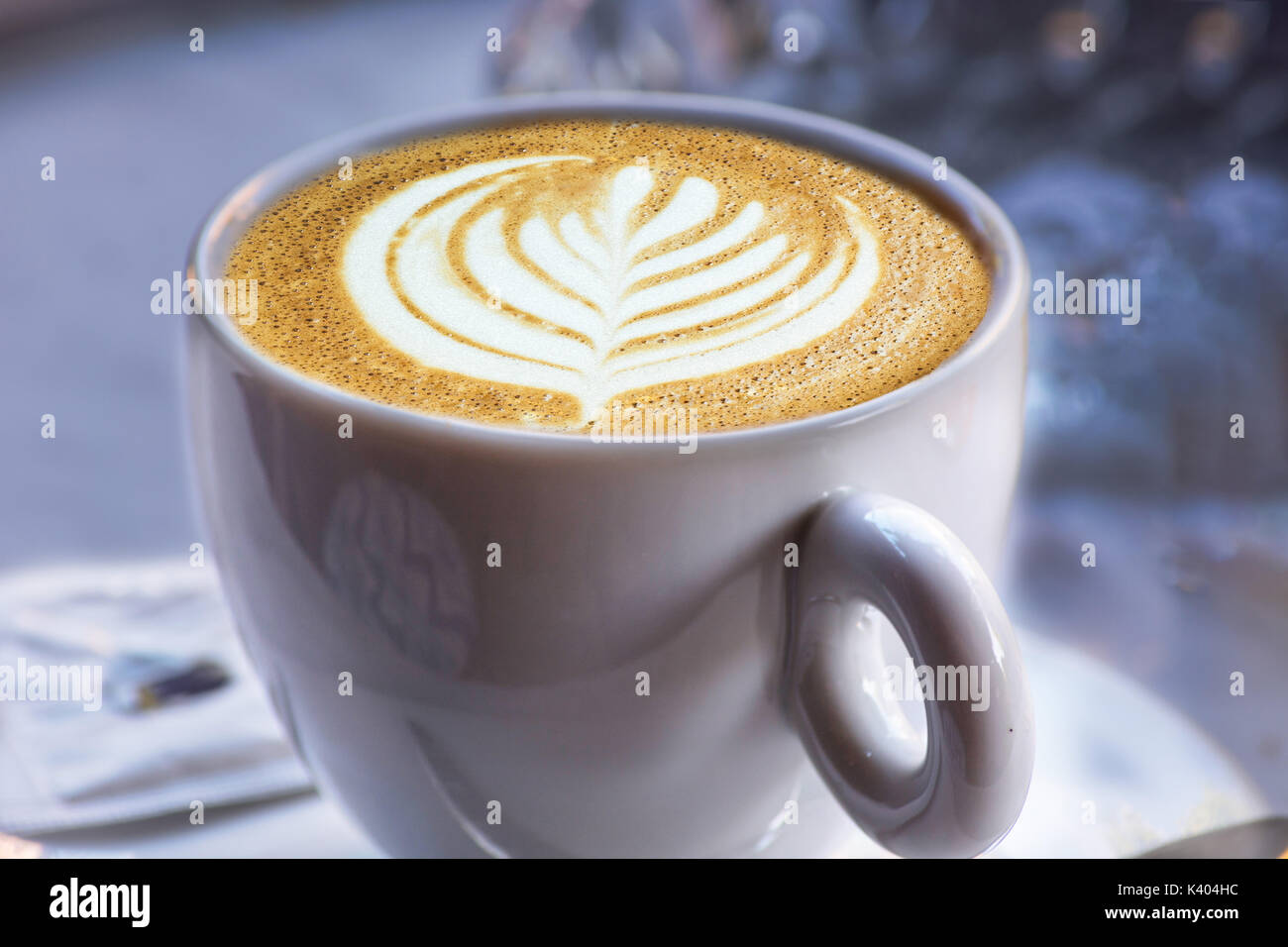 A white cup of coffee latte art before bokeh background Stock Photo