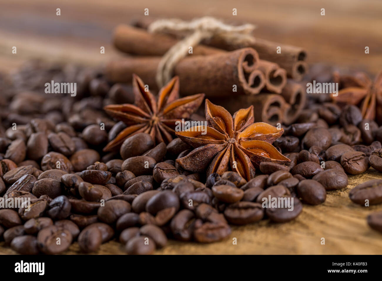 Coffee grains, anise and canella on old planks - Stock Image