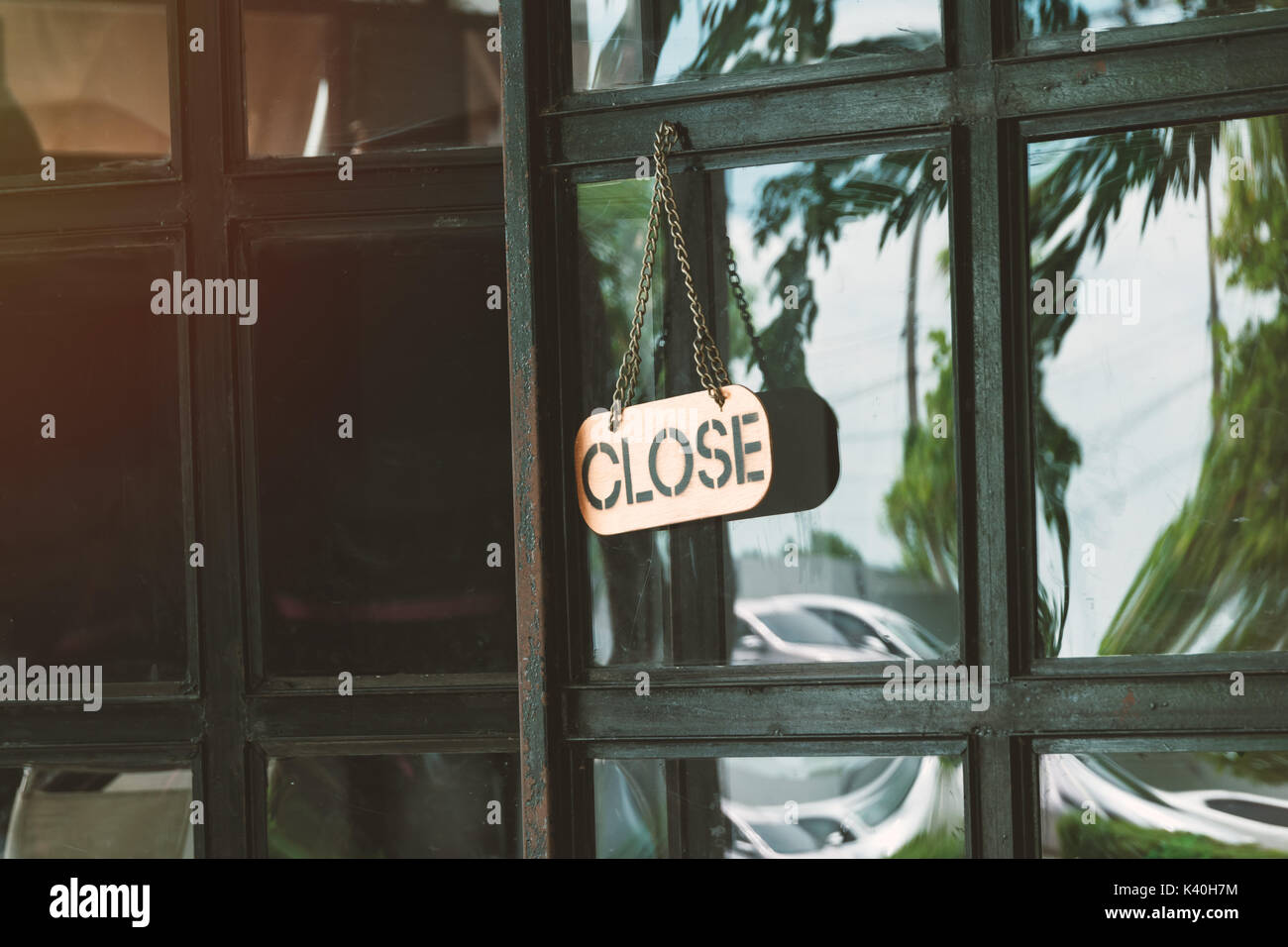 close sign in a shop door concept for The store closes - Stock Image