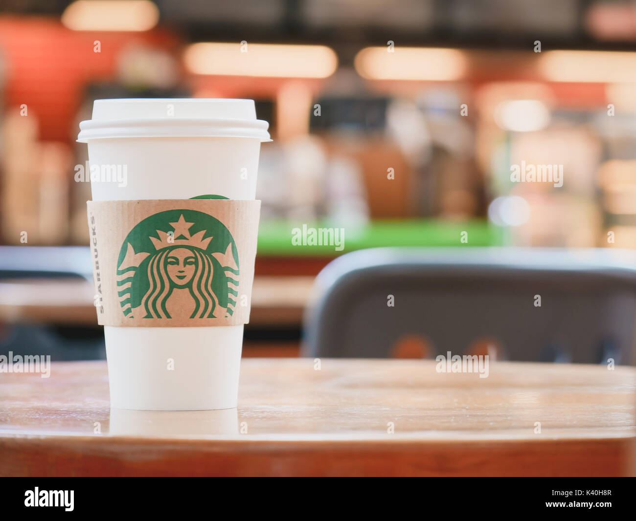 BANGKOK ,THAILAND,1 JULY 2017 : A Cup of Starbucks hot beverage coffee on the table in the Starbucks drive thru shop. Starbucks is the world's largest coffeehouse company - Stock Image