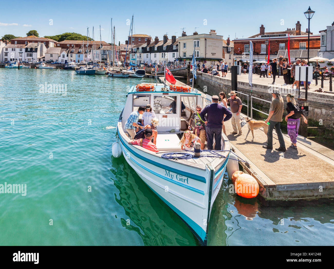 2 July 2017: Weymouth, Dorset, England, UK - Passengers with a dog boarding the pleasure boat My Girl at Weymouth Docks on a sunny summer day. - Stock Image