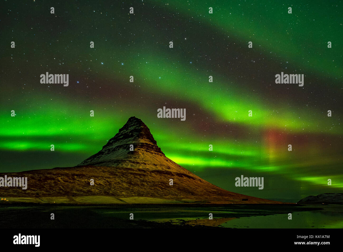Kirkjufell and Aurora in Iceland Stock Photo