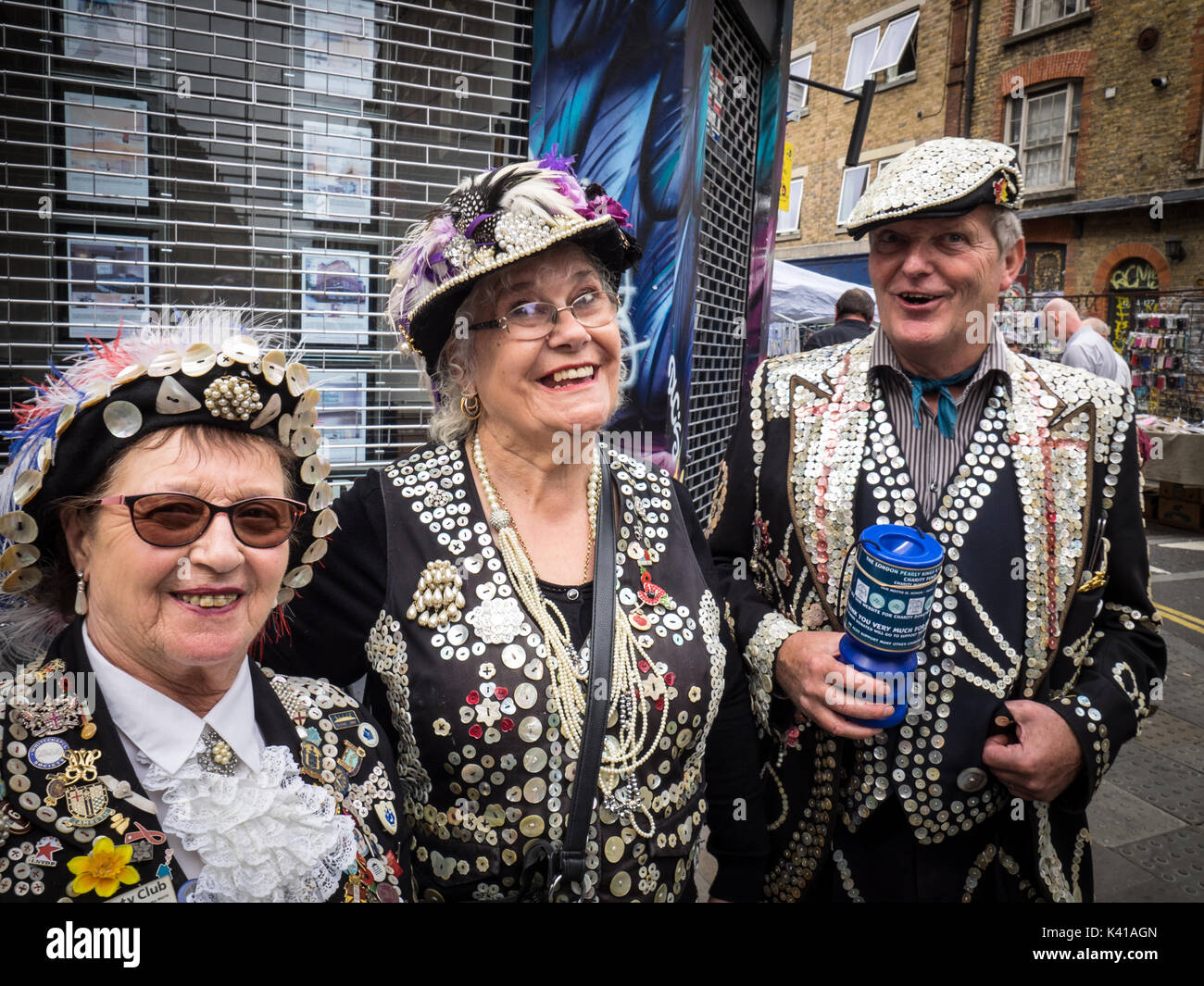Pearly Kings and Queens collect money for Charity on Sunday mornings in London's popular Brick Lane market in Spitalfields, East End, London UK - Stock Image