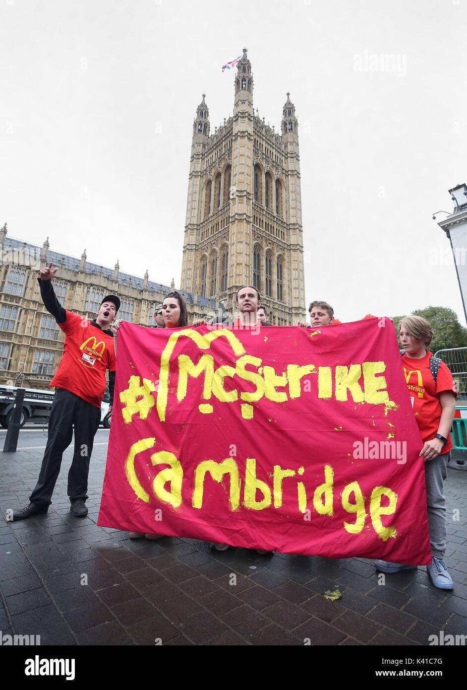 Supporters and workers from McDonald's restaurants in Cambridge during a rally at Old Palace Yard, London, after they voted overwhelmingly in favour of industrial action, amid concerns over working conditions and the use of zero-hour contracts. - Stock Image
