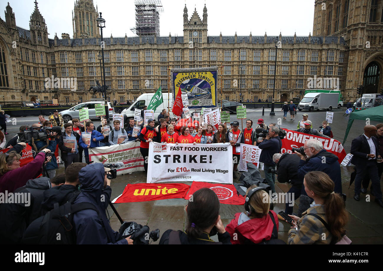 Supporters and workers from McDonald's restaurants in Cambridge and Crayford, SE London, during a rally at Old Palace Yard, London, after they voted overwhelmingly in favour of industrial action, amid concerns over working conditions and the use of zero-hour contracts. - Stock Image
