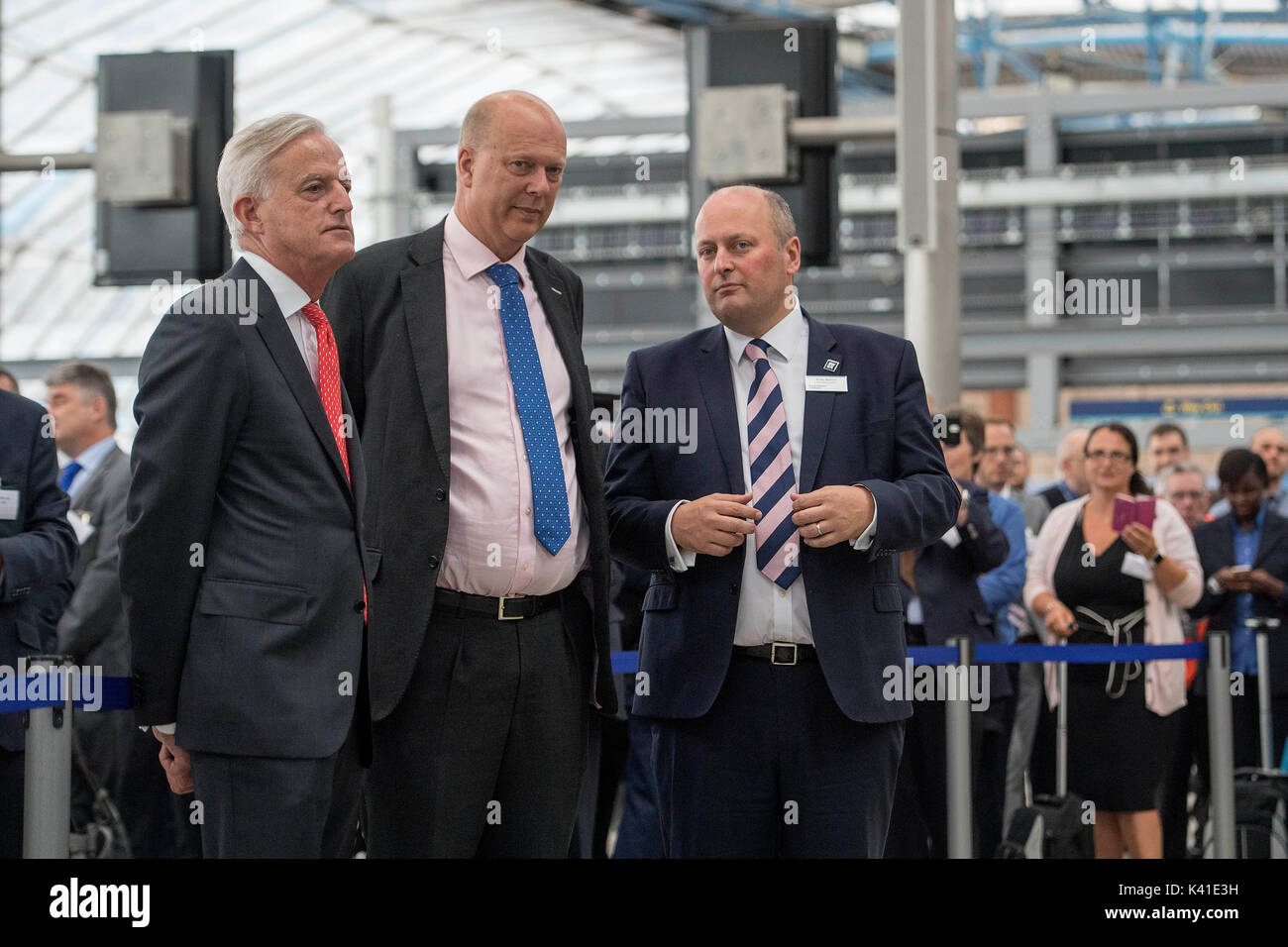 (Left to right) FirstGroup chief executive Tim O'Toole, Transport Secretary Chris Grayling and South Western Railway managing director Andy Mellors at Waterloo station in central London after South Western Railway's first fully-liveried Class 444 train arrived into the former international terminal. - Stock Image