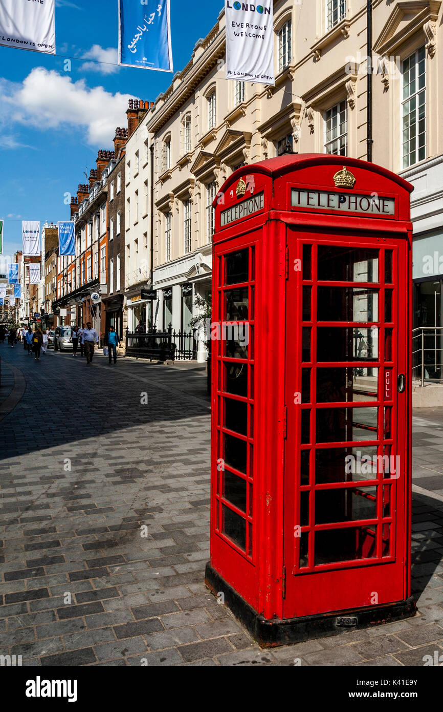 Traditional Red Telephone Box In South Molton Street, Mayfair, London, UK - Stock Image