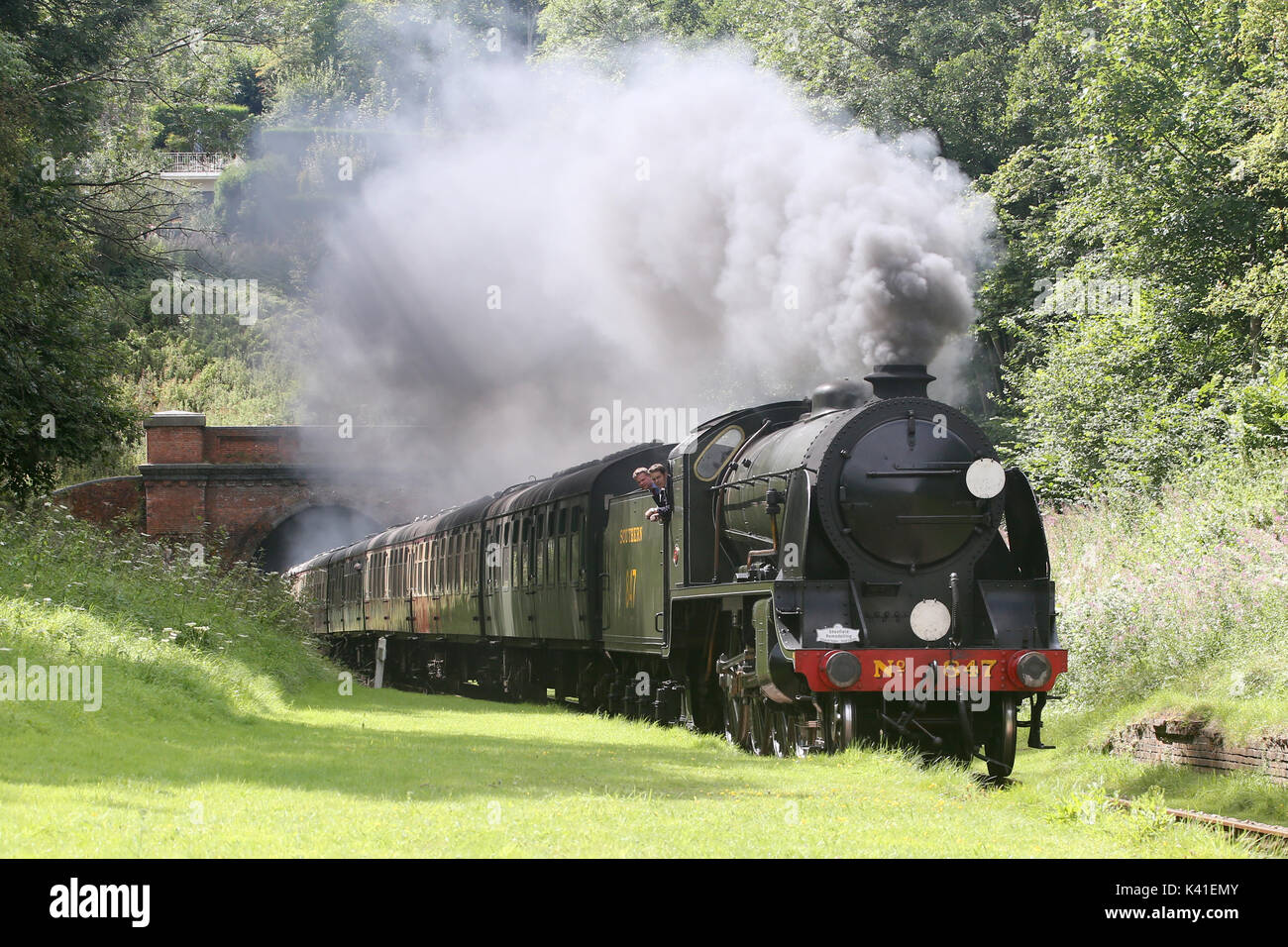 SR Maunsell S15-class No.847 4-6-0 on the  Bluebell railway hauling a train through Sharpthorne tunnel Sussex - Stock Image