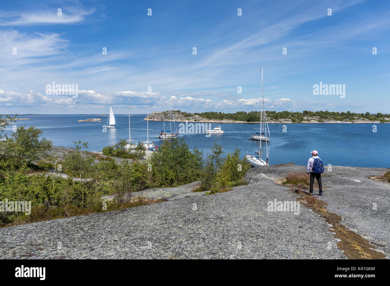 Sailboats anchored at an island in the outer reaches of the Stockholm archipelago - Stock Image