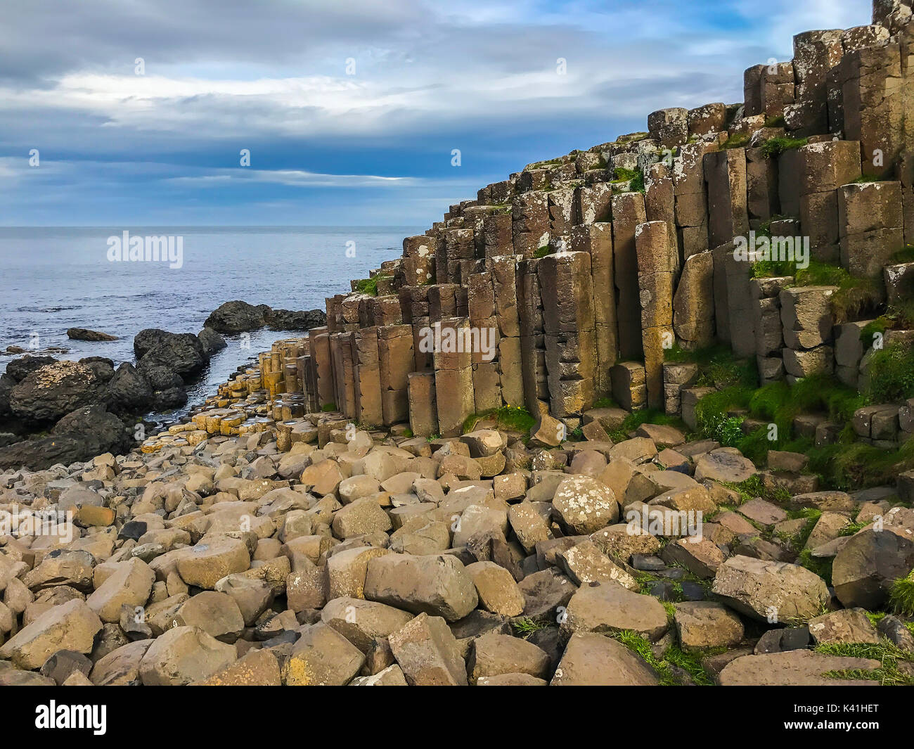 Beautiful scenery with basalt columns sticking out of the ground at Giants Causeway in Northern Ireland in the county of Antrim in the United Kingdom, - Stock Image