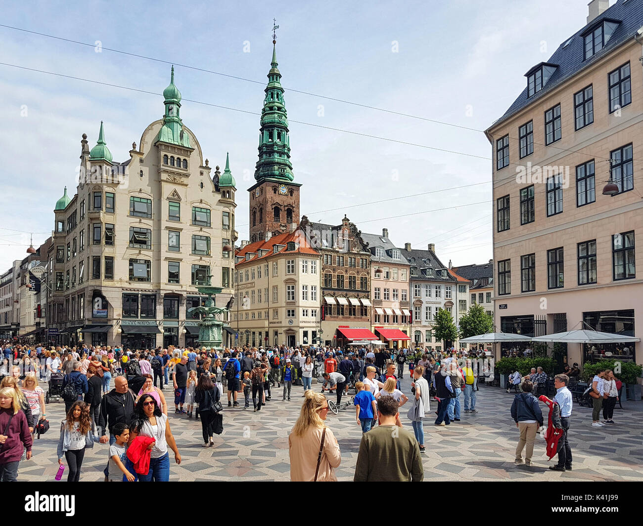 Copenhagen, Denmark - July 24, 2017: Tourists visiting  Amager Square (Amagertorv). It is one of the oldest square of Copenhagen - Stock Image