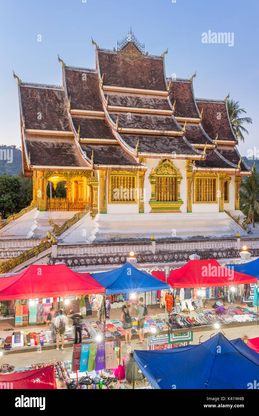 Famous night market and the Haw Pha Bang temple in Luang Prabang, inside the Royal Palace complex, in Laos - Stock Image