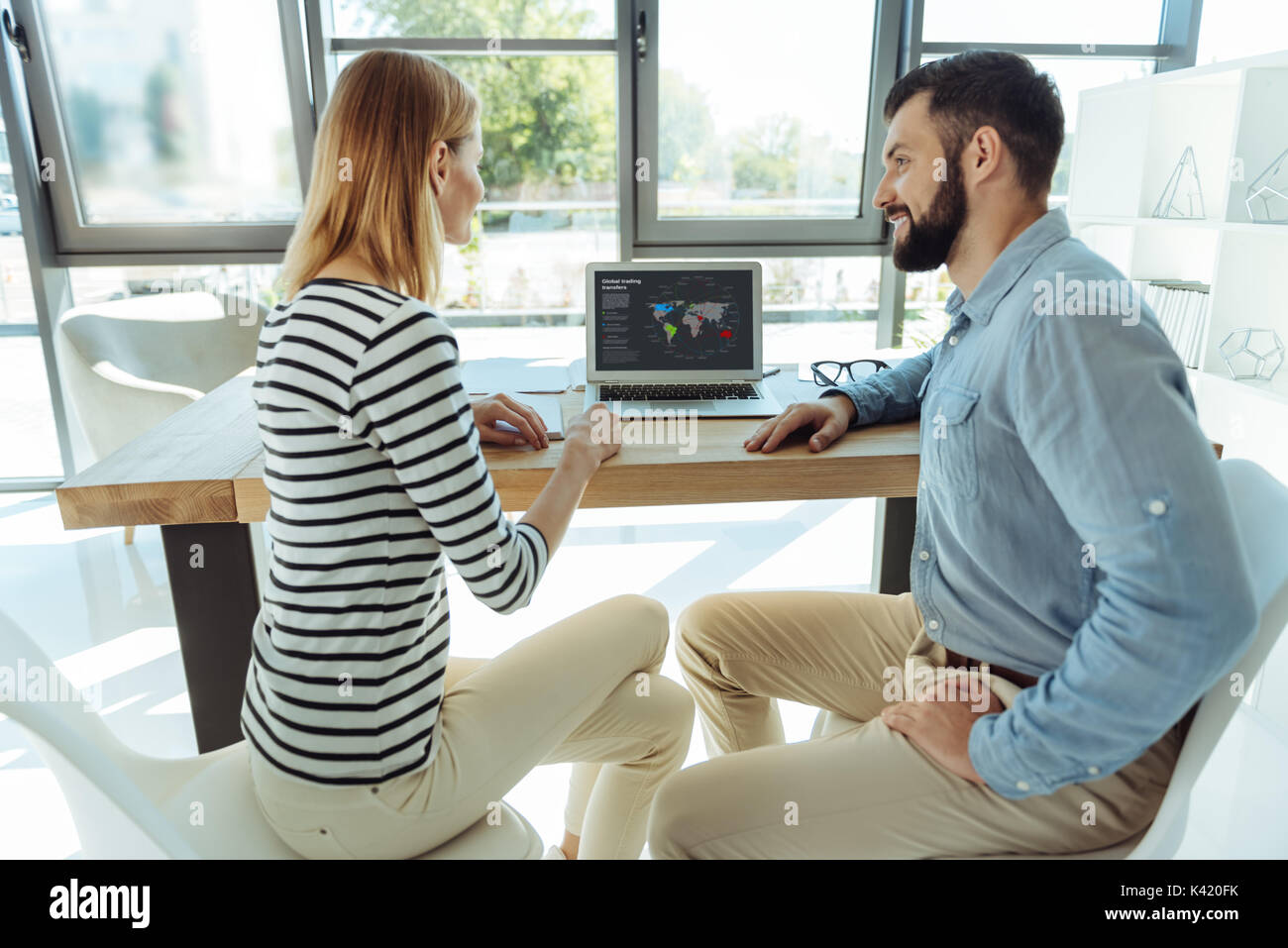 Young office workers discussing their common project - Stock Image