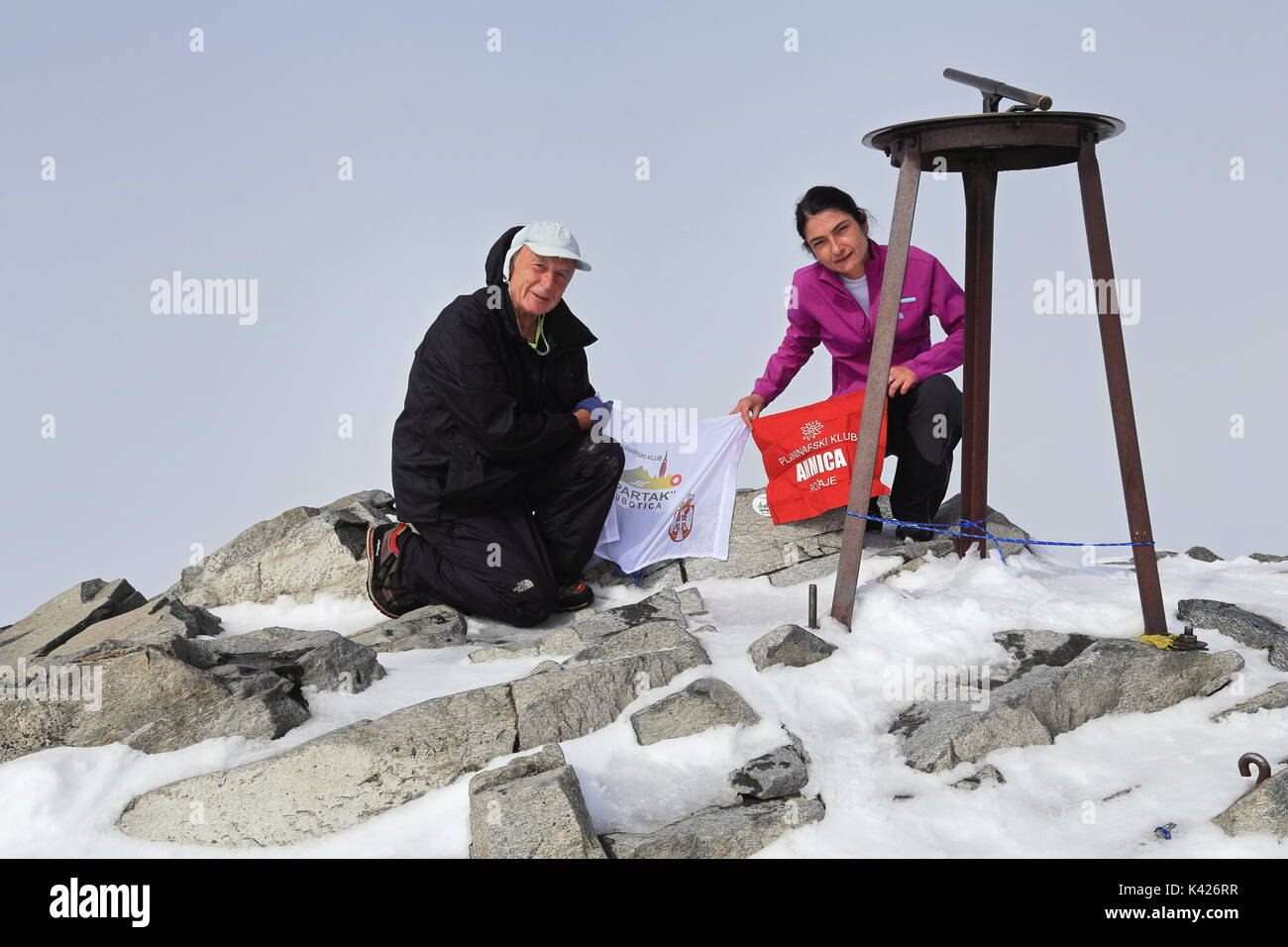 Hikers on top of Galdhopiggen the highest point of Norway and Scandinavia and Northern Europe - Stock Image