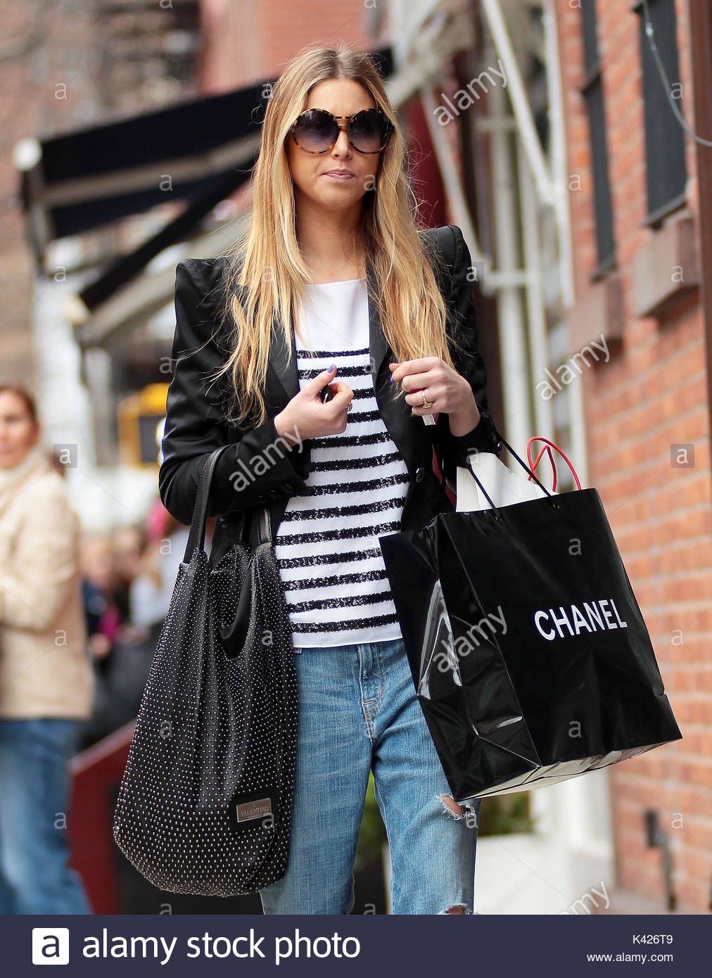 91e26a5d4cd7 Whitney Port. Whitney Port carries a Valentino bag on one arm and a big  black Chanel bag on the other while out and about in NYC.