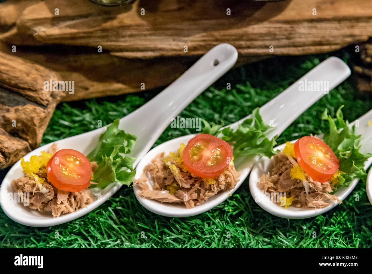 Vareity of canape on spoon - Stock Image