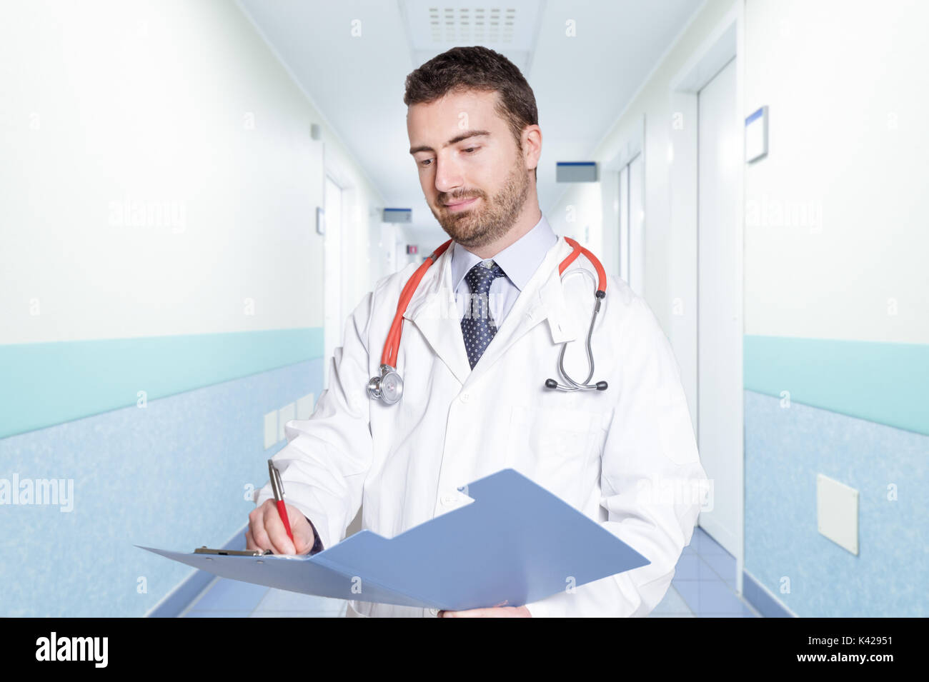 Doctor portrait on hospital corridor background - Stock Image