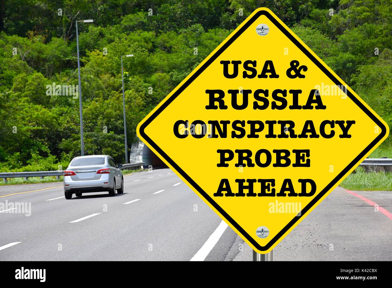 USA And Russia Conspiracy Probe Ahead, warning road sign - Stock Image