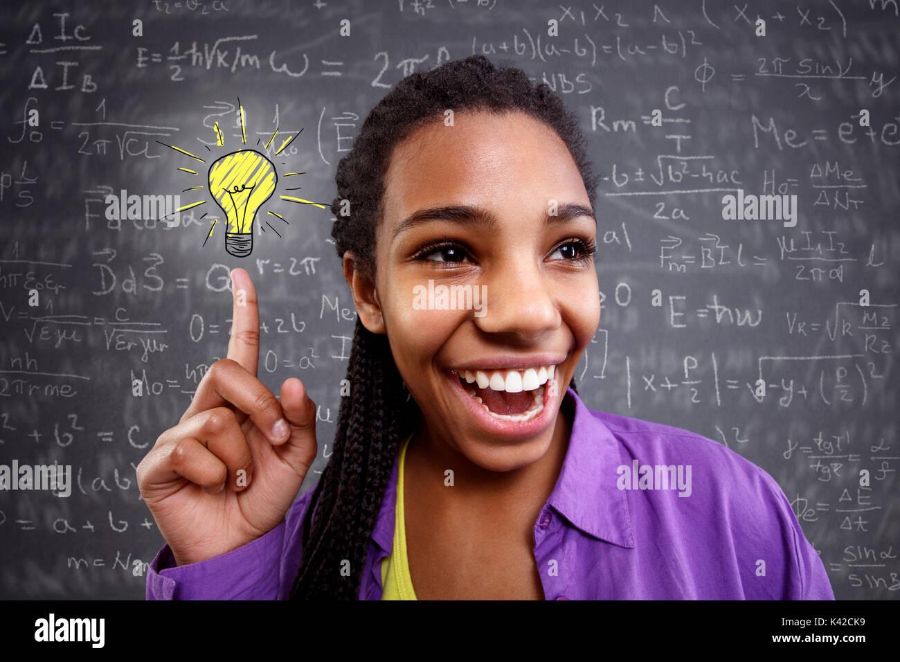 happy schoolgirl genius in mathematics have a solution - Stock Image