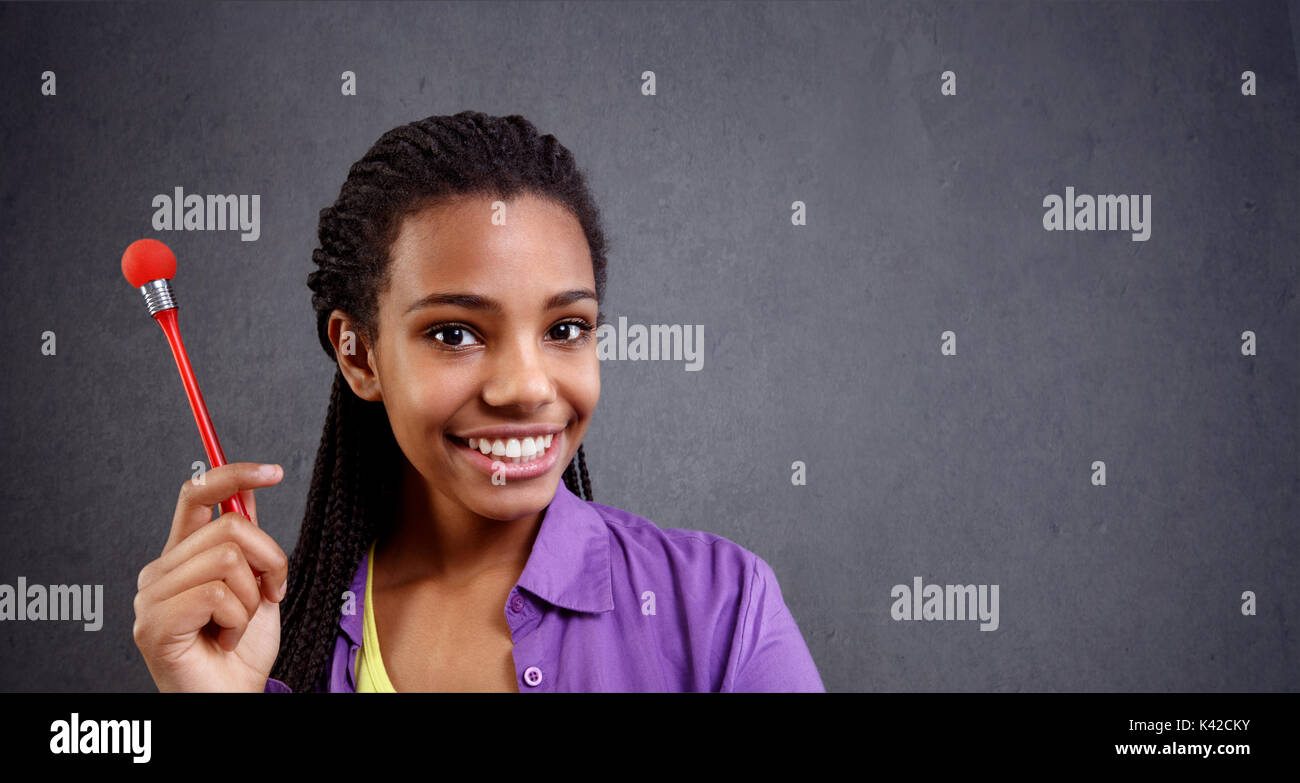 schoolgirl thinking idea about her dreams at cloud - Stock Image