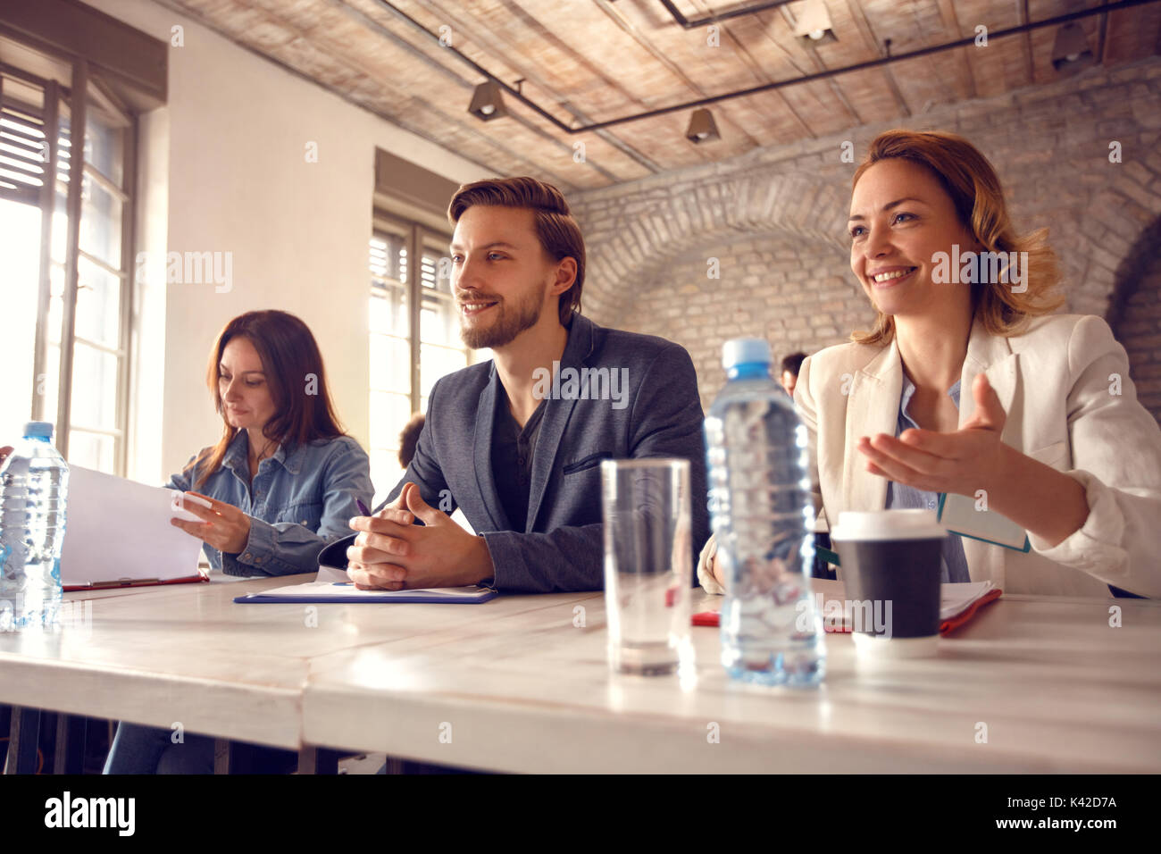 Satisfied three members commission with candidate on job - Stock Image