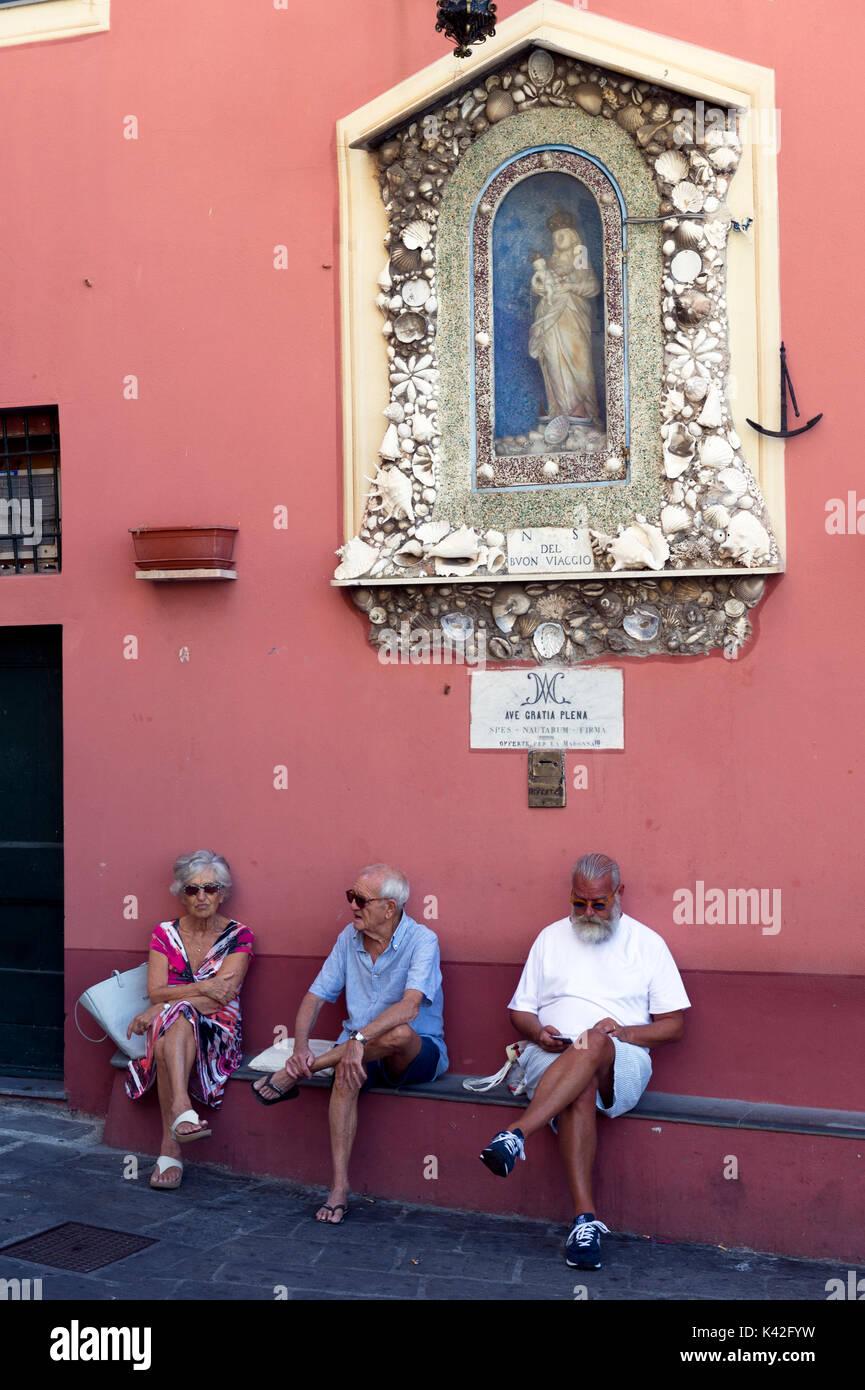 Italy. Liguria. The fishing village of Camogli. Elderly people relaxing in Camogli - Stock Image