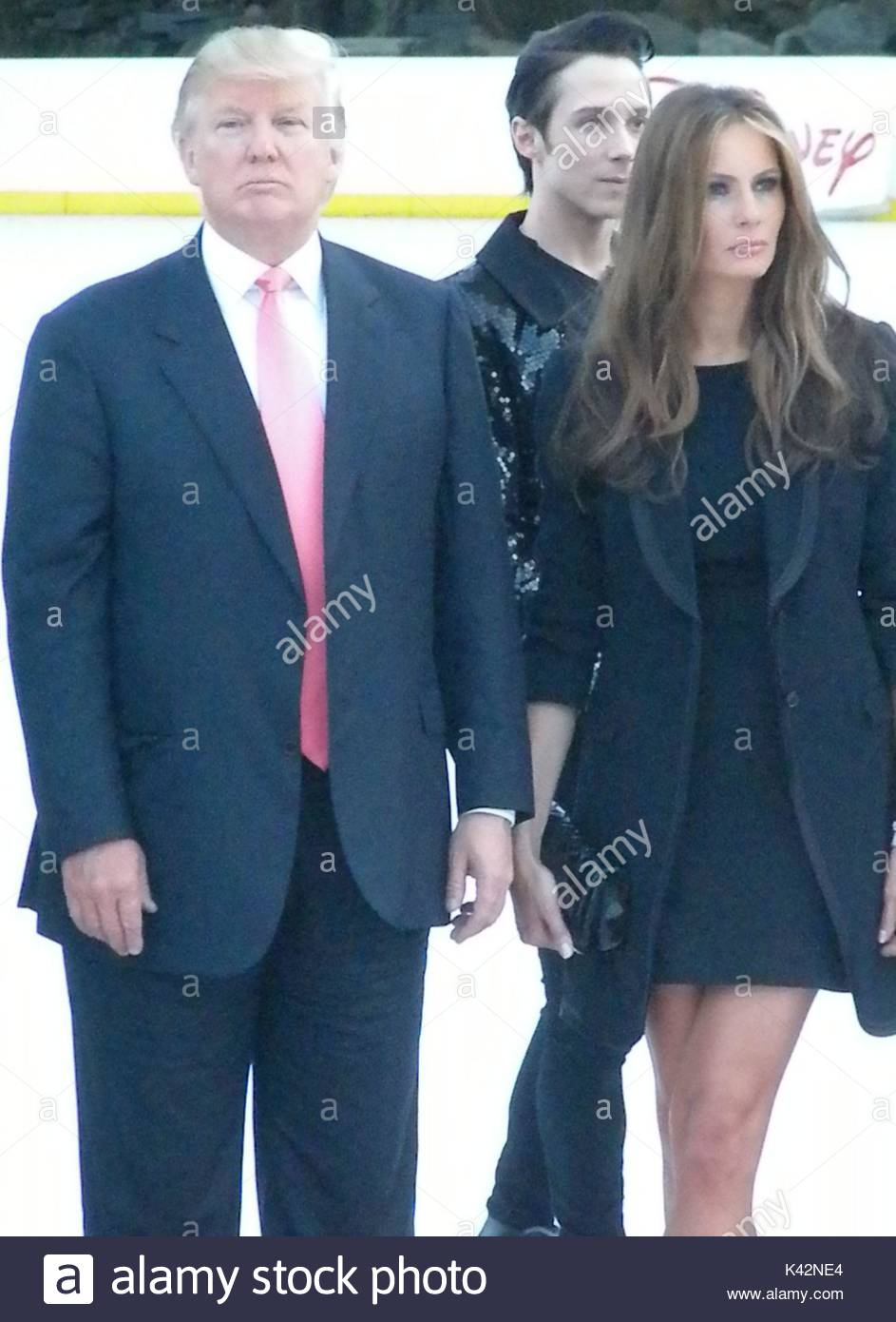 Donald trump johnny weir and donald trumps wife melania trump after the skating with the stars sws ceremony celebrities meet and greet at the trumps wollman rink located in central park nyc m4hsunfo